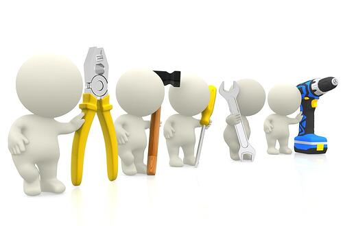 3D guys holding tools - isolated over a white background