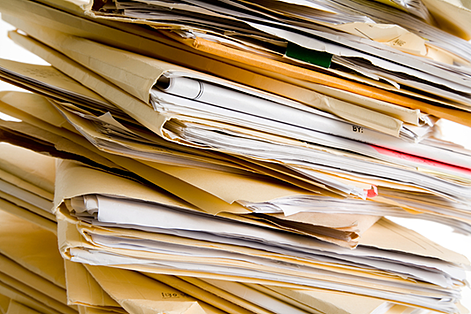 A pile of paper files which SMCR Documentations