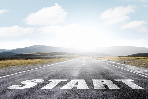 Start word as motivation written on asphalt road